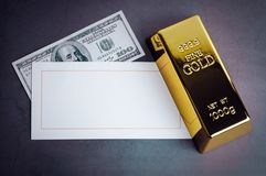 Gold bar ingot bullion dollar bill and greeting card stock photography