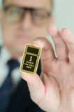 Gold Bar Ingot. Gold bar inspected by a business man Stock Images