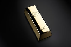 Gold bar. 1 kilo of the gold bar on black background Royalty Free Stock Image