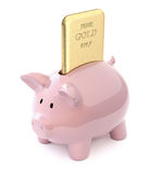 Gold bar in piggy bank Royalty Free Stock Photography