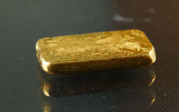 Gold bar put on the dark background Stock Image