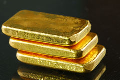 Gold bar put on the dark background. Stock Image