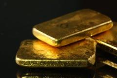Gold bar put on the dark background. stock image