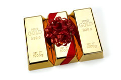 Gold Bar with Red Ribbon, studio shots Royalty Free Stock Image