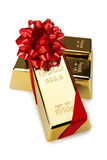 Gold Bar with Red Ribbon, studio shots Stock Images