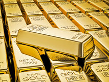 Gold bar on stacks of gold bullions close up Royalty Free Stock Photo