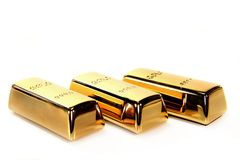 Gold bars. Three gold bars on a white background Royalty Free Stock Images
