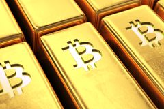 Gold bars with bitcoin symbol close up. Macro view of a shiny golden bars with bitcoin symbols. Fine gold ingot close up. Cryptocurrency market, blockchain Royalty Free Stock Image