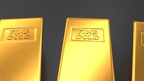 Gold bars on black backgrounds stock footage