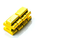 Gold bars bricks on white background. Soft focus, shallow depth of field photography, copy space.  Royalty Free Stock Photography