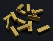 Gold bars in bulk on a black background Stock Images