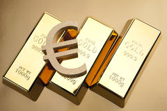 Gold bars closeup top view with euro mark Stock Photo