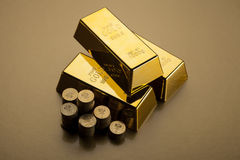 Gold bars and coins Royalty Free Stock Images