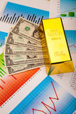 Gold bars and coins, ambient financial concept.  Stock Photo