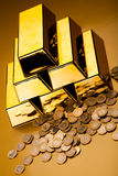 Gold bars and coins, ambient financial concept.  Stock Photography