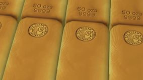Close-up view of gold bars placed in perfect rows with ambient light. Gold bars concept of banking and ultimate wealth. Close-up view of gold bars placed in stock video