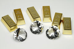 Gold bars and diamonds. Are together on the picture Stock Photo