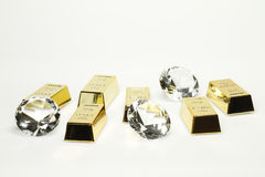 Gold bars and diamonds. Are together on the picture Royalty Free Stock Photography