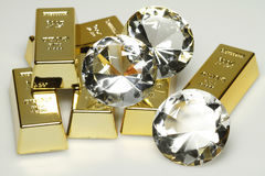 Gold bars and diamonds Stock Photo