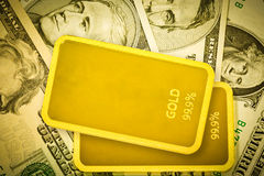 Gold bars and dollar Stock Images