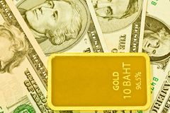 Gold bars and dollar Stock Photo