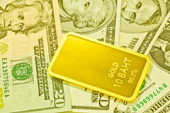 Gold bars and dollar Stock Photos