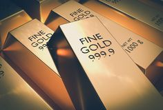 Gold bars - financial success and investment concept. Gold bars or ingot - financial success and investment concept - retro style Stock Photo