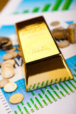 Gold bars with a linear graph, ambient financial concept Stock Photo