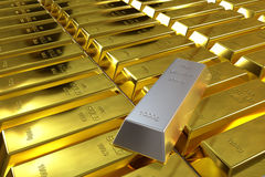 Gold bars and one silver bar Stock Photos