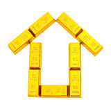 Gold bars shape like a house with clipping path Stock Images