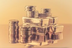 Gold bars and stack of gold coins. Background for finance banking concept. Trade in precious metals. stock images