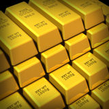 Gold bars stacked in a group. Group of Gold bars in a large stack representing the concept of wealth and financial security Royalty Free Stock Photography