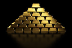 Gold bars stacked in a pyramid Royalty Free Stock Photos