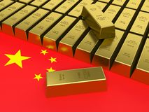 Gold bars on top of a china flag. Stock Photo