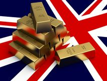Gold bars on top of a uk flag. Stock Photo