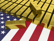 Gold bars on top of a USA flag. Royalty Free Stock Photo