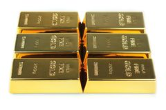 Gold bars on white background Stock Image