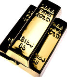 Gold bars. On white background with dark reflections Stock Images
