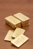 Gold Bars on Wood Surface Royalty Free Stock Photos