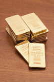 Gold Bars on Wood Surface Royalty Free Stock Photography