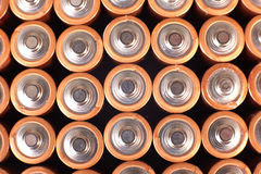 Gold batteries in rows Stock Photo
