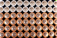 Gold batteries in rows Stock Image