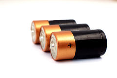 Gold batteries in rows Stock Images