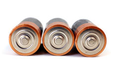 Gold batteries in rows Stock Photos