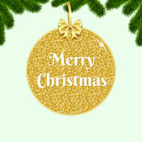Gold bauble and bow on background with fir-tree branches. Stock Photography