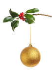 Gold bauble and Holly Stock Images