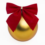 Gold bauble and red ribbon. Merry Christmas gold bauble and red ribbon isolated on white Royalty Free Stock Photo