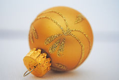 Gold bauble. Single little gold Christmas baubles with gold glitter Stock Image
