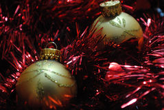 Gold baubles nesting in red tinsel (5) Stock Image