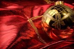 Gold baubles with red backdrop Stock Images